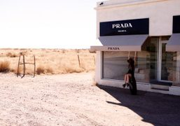 Pamela Love in front of the Prada store designed by Elmgreen and…