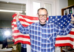 Terry Richardson holding the American flag at Purple Institute, Paris. Photo Olivier…