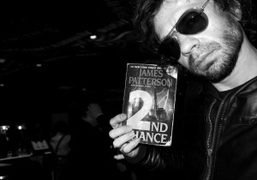 Olivier Zahm holding James Patterson's book Second Chance at Mama Shelter, Paris….