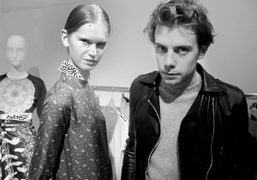The London-based designer J.W. Anderson and a model at the private cocktail…