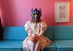 The eccentric artist Anne Koch at home wearing her favorite Transformers' mask…