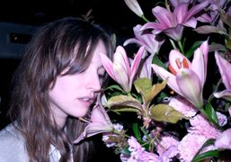 Model, stylist and Purple muse Valentine Fillol Cordier with flowers, London. Photo…