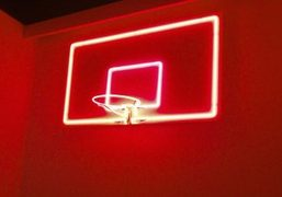 A neon basketball artwork by Ivan Navarro at the Galerie Templon booth...